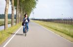 Groot Schiphol ondernemers en bestuurders stappen samen op de fiets in Schipholregio
